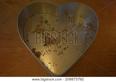 Heart shaped cookie box with only cookie Crumbs left