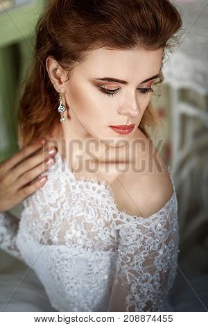 Portrait of beauty bride in white dress. Classic style