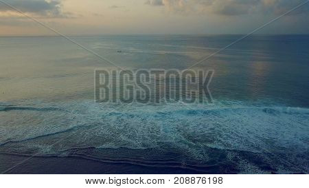 ship amongst strong big waves in the ocean in bali indonesia
