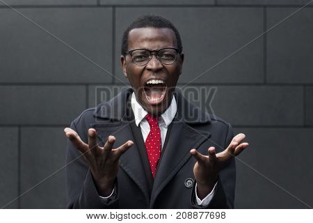 Urban Closeup Of Handsome African Male Standing Isolated Against Grey Wall Wearing Formal Clothes An