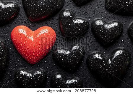 Water Drops On Red And Black Hearts