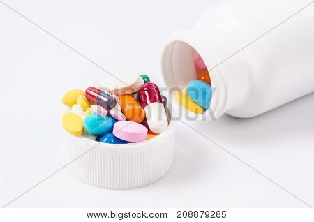 The medicine in plastic bottle and pills.