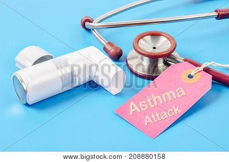 Asthma attack tag with asthma inhaler with stethoscope medical on blue background.