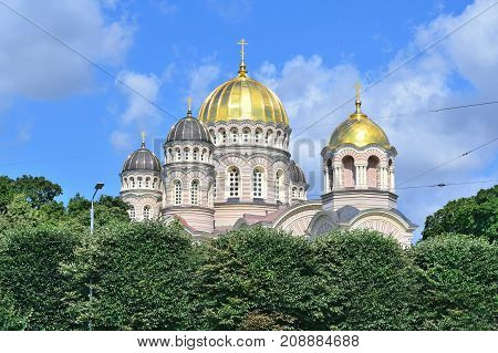 Riga Latvia. Very beautiful Orthodox cathedral surrounded by trees in a sunny summer day