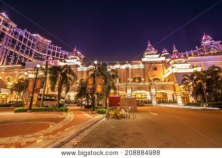 Macau, China - December 8, 2016:illuminated front parking at night of Shining Galaxy casino hotel in Cotai Strip of Macau for laser show. Macau is Asian gambling capital, visited by millions of people