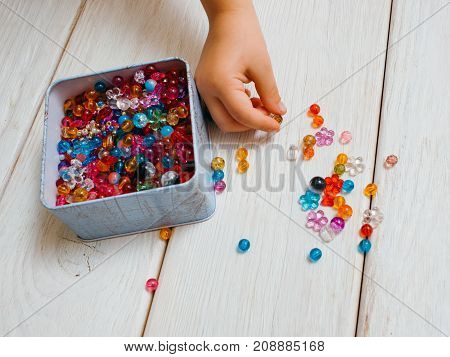 Art creation process. Girly hobby. Colorful decoration tools closeup, unrecognizable child artist. White background top view, creativity concept
