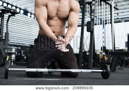 Muscular Man Clap Hand In Fitness Center. Male Athlete Pump Up Muscle In Gym. Weightlifter Work Out