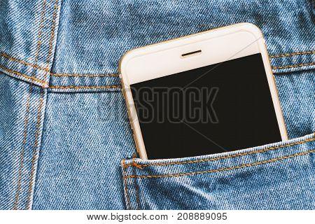 Smartphone in back of pocket blue jean