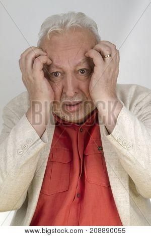 Senior man with strong headache - on bright background