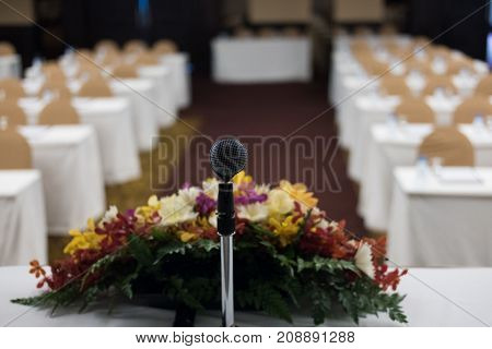 Microphone In Modern Conference Hall Interior With White Chairs. Seminar Room With Empty Seat. Busin