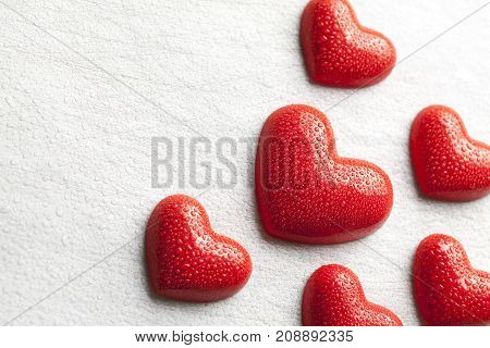 Red Figures In The Shape Of A Heart Dewy Water On Scratched Background