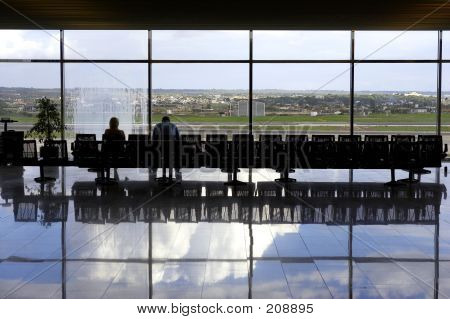 Two Passengers Waiting In Airport Lounge