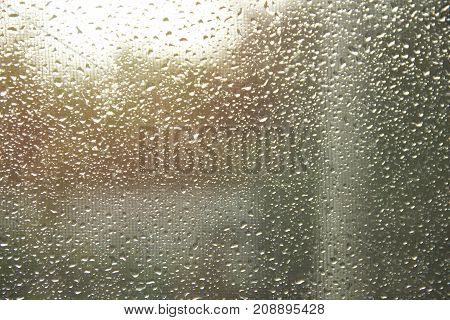 Drops on the glass after the rain in the sunlight.Design Element