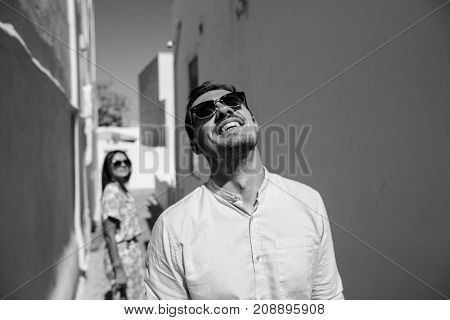 Happy Couple Hugging And Laughing Together With A View Of Santorini, Black&white Photo