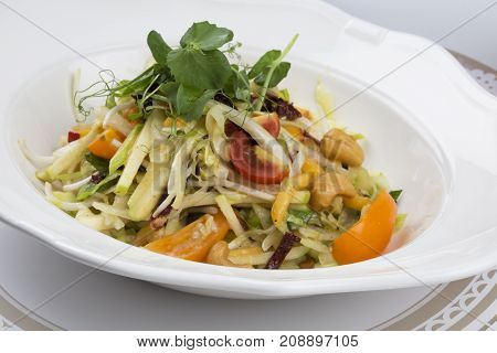 vegetable salad with bean, parsley, tomato, bean, apple, soybean sprouts, yellow paper and dried tomatoes