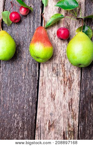Pear And Small Apple On Wooden Rustic Background. Top View. Frame. Autumn Harvest. Copy Space.