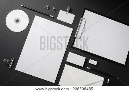 Blank stationery set on black background. Corporate identity template. Mock-up for branding identity. Top view.