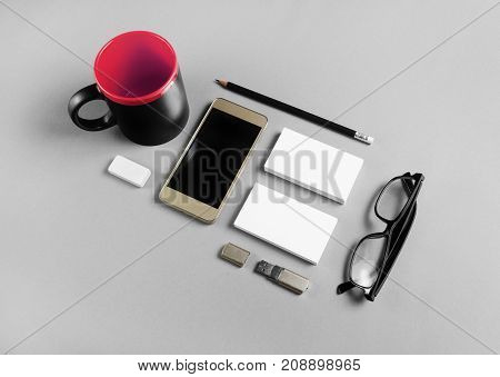 Brand identity mockup. Blank stationery and gadgets on gray background.