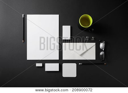 Photo of blank stationery set on black background. Template for branding identity for designers. Top view.