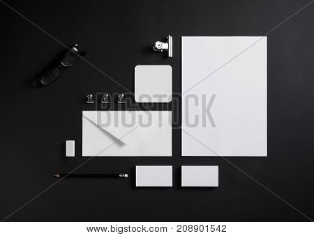 Blank stationery set on black paper background. ID template. Mockup for branding identity for designers. Top view.
