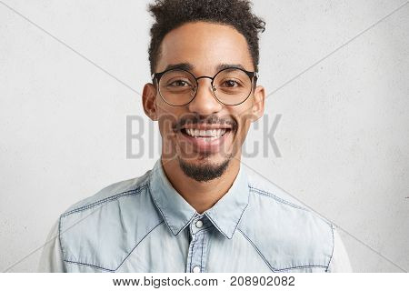 People, Positiveness And Happiness Concept. Glad Smiling Male Teenager Wears Big Spectacles, Being H