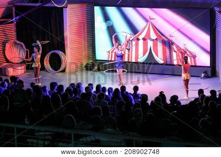 Yalta, Crimea - 11 July, Group of girls with hoops in front of the audience, 11 July, 2017. Performance of young artists on the stage of the hotel Yalta Intourist.