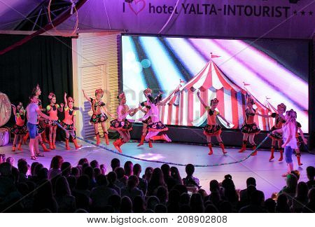 Yalta, Crimea - 11 July, Dance folklore group of girls with skipping ropes, 11 July, 2017. Performance of young artists on the stage of the hotel Yalta Intourist.