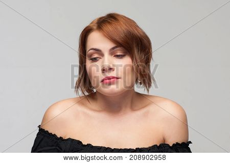 Female loneliness. Problems in relationships. Missing love partner, hard times in life. Sad woman on grey background, bad breakup, depression concept