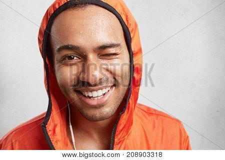 Glad Wet Guy With Shining Perfect Smile, Has Walk On Rainy Weather, Enjoys Favourite Track In Earpho