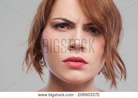Distrust in partner. Suspicious look. Relationships problems, angry female portrait on grey background closeup, suspicion concept
