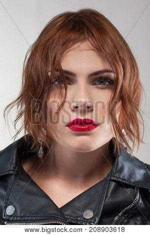 Modern stylish youth. Hairstyle advertising. Confident female, fashion woman portrait closeup on grey background. Fashionable hair commercial, style concept