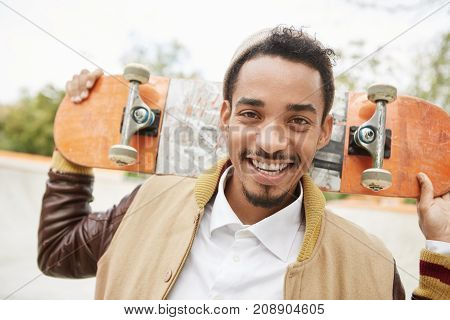 Happy Young Male Skateboarder Being Delightful After Spending Morning Saturday Outdoors, Rides Skate