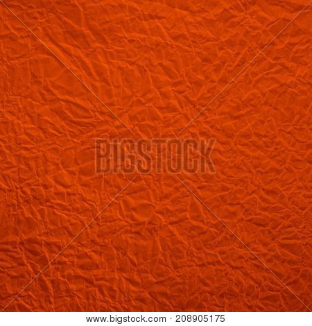 Red crumpled paper texture and background for pattern design.