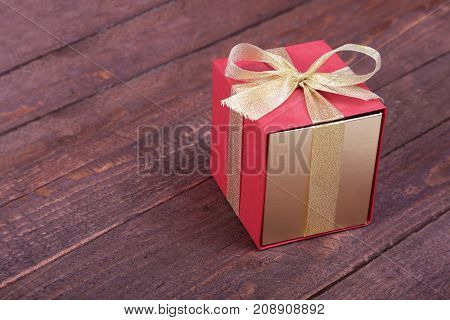 Gift boxes with bow on wood background.