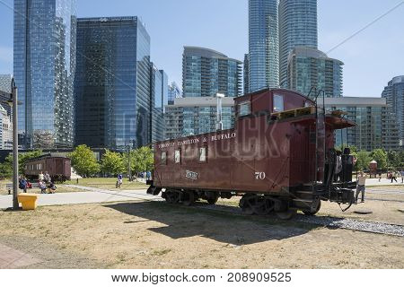 TORONTO,CANADA-AUGUST 2,2015:people visit the Toronto's railway heritage center with a view of skyscrapers during a sunny day