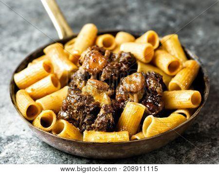 close up of a pan of rustic italian oxtail ragu pasta