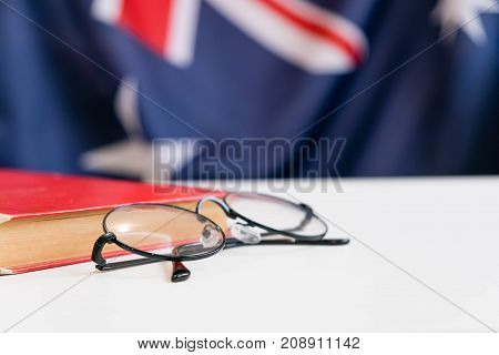 Australian flag in the middle of the book. Knowledge and education concept.