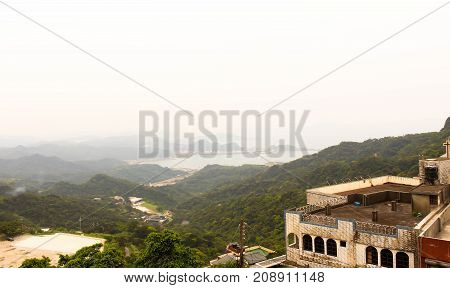 Scenic view of Jiufen old street Ruifang district with fog