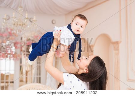 Child, childhood and infant concept - Cute little baby boy with mother at home.