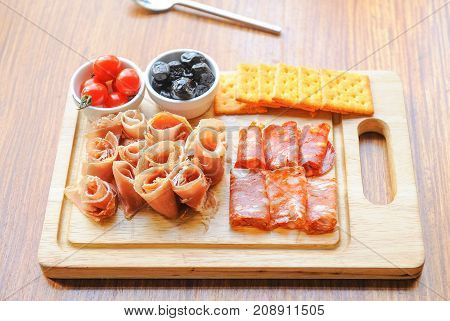 Antipasto platter cold meat plate and bake