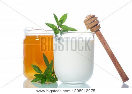 sweet homemade yogurt with honey on a white background