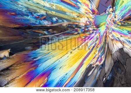 colorful micro crystals of liqueur in polarized light