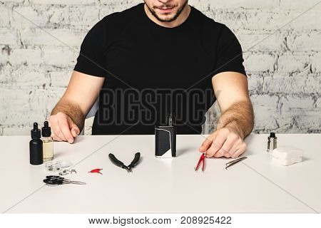 Master Repair Ecigarette On The White Table