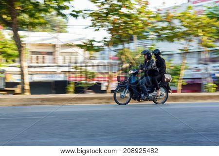 CHIANG MAI THAILAND - 11/5/2016: Motorbike in motion in Chiang Mai Thailand