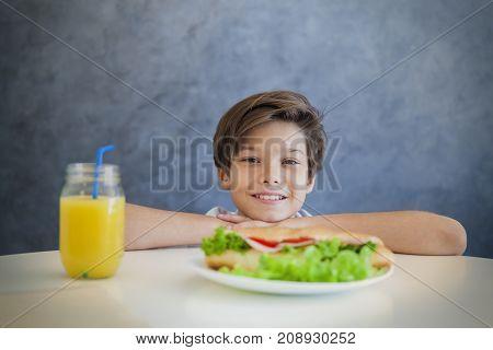 Happy Teen Boy Having Breakfast At Home