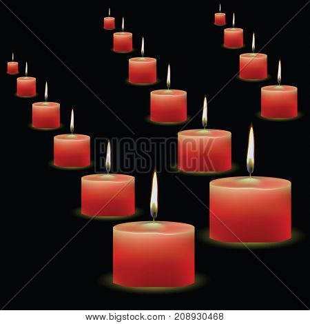 Burning red candles isolated on black background