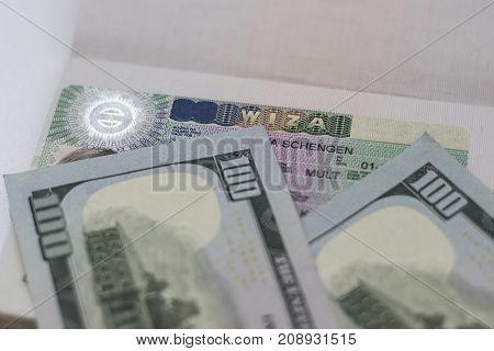 Fragment of Schengen visa in passport and money