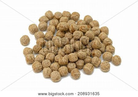 pile of rye balls on a white background