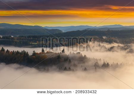 Rolling fog along Sandy River Valley in Clackamas County Oregon during sunrise