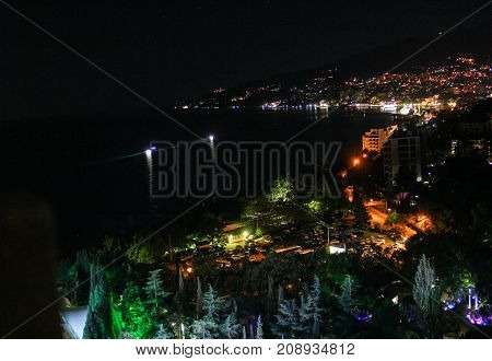 Lights on the sea. Night surroundings and adjoining territories of hotel Yalta Intourist.